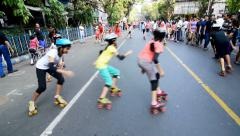City children rollerskating on Street, having fun - editorial footage.. Stock Footage