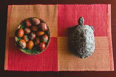 Easter eggs in a bowl and turtle Stock Photos