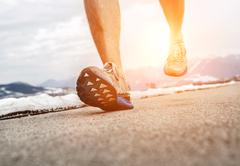 Stock Photo of Close up image runner legs in running shoes