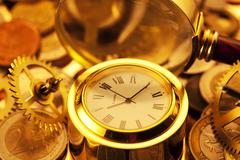 Gold watches, coins, gears and magnifying glass Kuvituskuvat