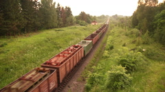 Freight train passing the forest, top view 03 Stock Footage