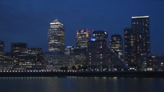 Canary Wharf Night View Skyscrapers London Financial Area Thames Boat Traffic Stock Footage