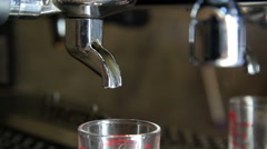 Close up to fresh coffee going out from a coffee espresso machine - stock footage
