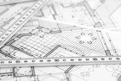 Stock Photo of metric folding ruler and architectural drawings of the modern house