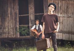 Young tramps guys near the lost house Stock Photos