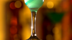 Turquoise cocktail with lime decortion and coconut on edge, rotation, cam moves Stock Footage