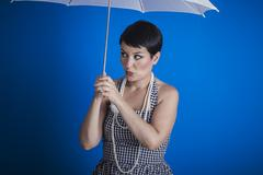 Stock Photo of Boring, pinup girl style of the 50s with a white umbrella