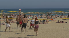 Playing volleyball on the beach in Barcelona Stock Footage