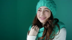beautiful young woman in a knitted hat posing - stock footage