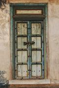 Traditional old door on home wall, vintage style Stock Photos