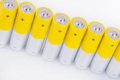Raw of AA alkaline batteries - stock photo