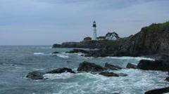 Maine lighthouse and rocky coast Stock Footage