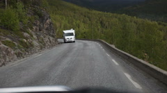 Meeting with the camper on a narrow mountainous road in Lofoten Stock Footage