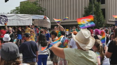 Multiple many rainbow flags waving during gay pride parade in slow motion Stock Footage