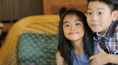 Portrait of asian kids, happy asian boy and girl looking at camera and smiling. - stock footage