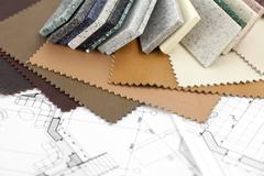 Stock Photo of color samples of architectural materials and architectural drawings of the mo
