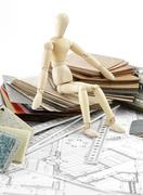 Wooden man, color samples of architectural materials - plastics,  Metric Fold - stock photo