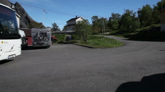 Bus with tourists leaving a parking space in Lofoten Norway Stock Footage