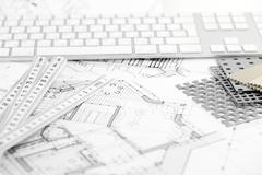 computer keyboard, samples of materials and architectural plans - stock photo