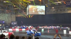4k Drift challenge racing Motorshow indoor automobile fair - stock footage