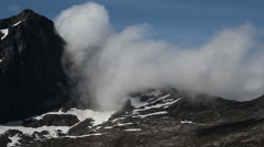 Clouds over a mountain top on Vaeröy Lofoten Norway Stock Footage