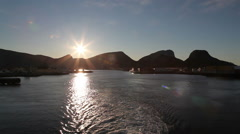 Leaving Lofoten Islands by boat at sunset Stock Footage