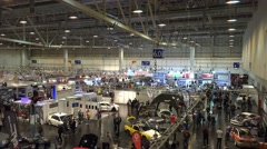 4k Visitors at motorshow automobile fair indoor overview - stock footage