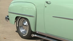 Classic car show, chrome hubcap slow Stock Footage
