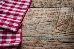 Red fabric tablecloth textile on wooden background Stock Photos