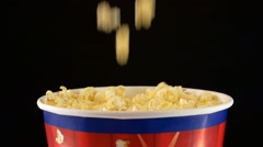 Popcorn falling in a bag, on black, 2 pack, slow motion Stock Footage