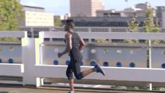 Athlete Runs On Top Level Of Empty Parking Garage (Slow Motion) Stock Footage