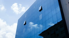 Timelapse Of Clouds Reflected In Corporate Office Building - stock footage