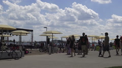 People enjoying nice sunny day (Canada Park) at Harbourfront, Toronto Stock Footage
