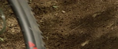Slow Motion Tires Kicking up Dirt on corner - Mountain Bike Stock Footage