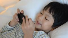 boy playing games on smart phone - stock footage