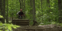 Extreme Sport - Downhill Mountain Biking - X-up bar turn trick Stock Footage