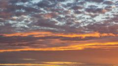 Timelapse View of Clouds Moving and Changing Color at Sunset Stock Footage