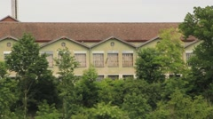 Factory Type Building on Cliff over Rhine River Stock Footage