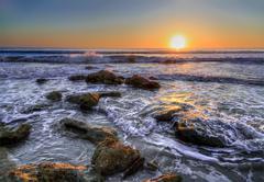 Atlantic ocean waves break on a coquina stone beach at Florida's Washington Oaks - stock photo