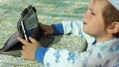 Boy sliding finger on the touchscreen and dancing smiling CLOSE UP Stock Footage