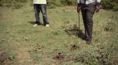 Measuring GPS point on land beacon marker, Africa, Kenya Stock Footage
