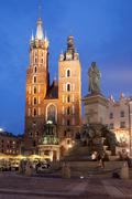 St Mary Basilica and Adam Mickiewicz Monument at Night in Krakow Stock Photos
