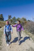 Women hiking at the mountain Kuvituskuvat