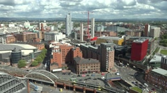 ULTRA HD 4K Aerial view Manchester public transportation skyline busy road train Stock Footage
