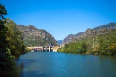 Dam built on Olt river on a sunny summer day - stock photo
