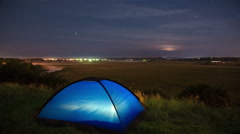 The camping tent by sunset (sunrise) and foggy above lake background - stock footage