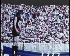 Stock Video Footage of aUSTRALIAN AFL Football Player Kicks Football (Archival Footage) 1970s