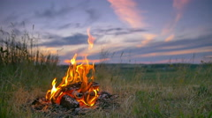 Stock Video Footage of The bonfire by picturesque sky background