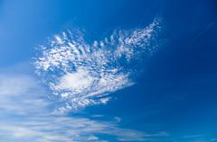 Blue sky with cirrus and stratus clouds, wide view Stock Photos