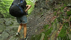 Young woman hiking with rucksack on the mountain trail footpath. Stock Footage